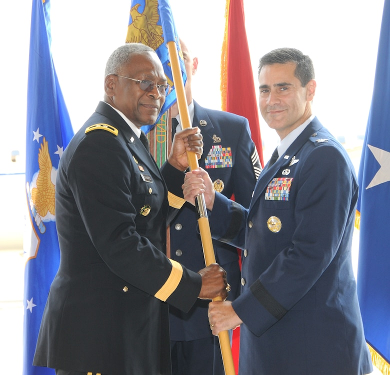 Brig. Gen. Marc Sasseville recieves the 113th Wing flag from Major General Errol Schwartz, Commanding General, D.C. National Guard, as General Sasseville assumes command of the 113th Wing from Brig. Gen. Jeffrey Johnson during the wing Change of Command ceremony, Joint Base Andrews, Md., Aug. 11, 2012.  (U.S. Air Force photo/Tech Sgt. Craig Clapper)