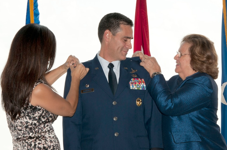 113th Wing Commander Col. Marc Sasseville, is pinned Brigadier General by his wife Karin Sasseville, and his mother Yita Sasseville during the 113th Wing Change of Command ceremony, Joint Base Andrews, Md., Aug. 11, 2012.  (U.S. Air Force photo/Master Sgt. Dennis Young)