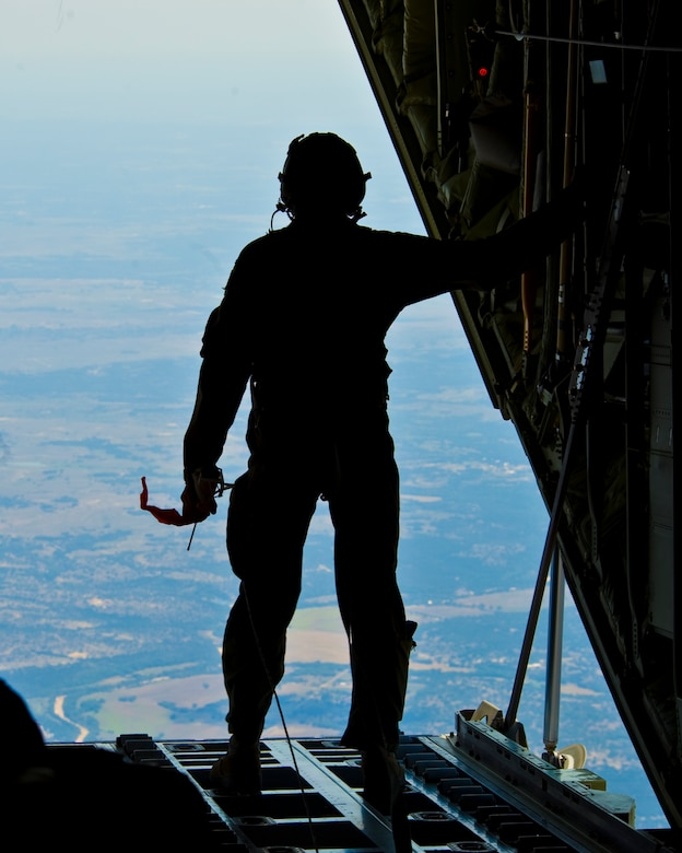 U.S. Air Force Airman 1st Class Korey King, 40th Airlift Squadron, prepares to release a wind sonde from a C-130J Super Hercules assigned to the 317th Airlift Group prior to an airdrop training mission Aug. 14, 2012, at Dyess Air Force Base, Texas.  This wind sonde device is part of Joint Precision Airdrop System (JPADS), and is released at high altitudes over a drop zone to measure the wind prior to an actual cargo drop.  JPADS is a cargo parachute system that incorporates an onboard global positioning system able to guide the cargo with pinpoint accuracy to a designated drop zone. JPADS also allows cargo to be dropped from higher attitudes, allowing aircraft to safely avoid enemy ground fire. (U.S. Air Force photo by Staff Sgt. Richard P. Ebensberger/ Released)