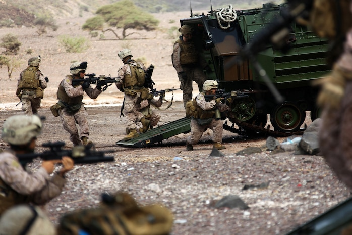 Marines with Alpha Company, Battalion Landing Team 1st Battalion, 2nd Marine Regiment, 24th Marine Expeditionary Unit, assault a beachhead during an amphibious training raid in Djibouti, Aug. 15, 2012. Elements of the 24th MEU are operating in and around Djibouti, taking part in and coordinating various unilateral exercises and bilateral events with foreign militaries. The 24th MEU is deployed with the Iwo Jima Amphibious Ready Group as a theater reserve and crisis response force in support of U.S. Central Command and the U.S. Navy's 5th Fleet area of responsibility. (U.S. Marine Corps photo by Cpl. Michael Petersheim)