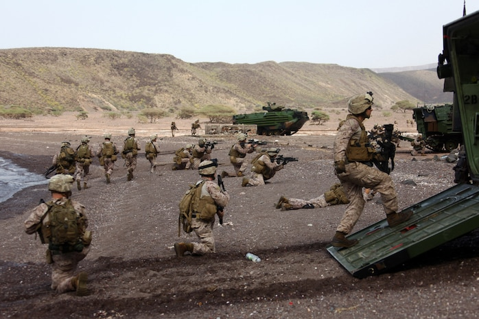 Marines with Alpha Company, Battalion Landing Team, 1st Battalion, 2nd Marine Regiment, 24th Marine Expeditionary Unit, assault a beachhead during an amphibious training raid in Djibouti, Aug. 15, 2012. Elements of the 24th MEU are operating in and around Djibouti, taking part in and coordinating various unilateral exercises and bilateral events with foreign militaries. The 24th MEU is deployed with the Iwo Jima Amphibious Ready Group as a theater reserve and crisis response force in support of U.S. Central Command and the U.S. Navy's 5th Fleet area of responsibility.