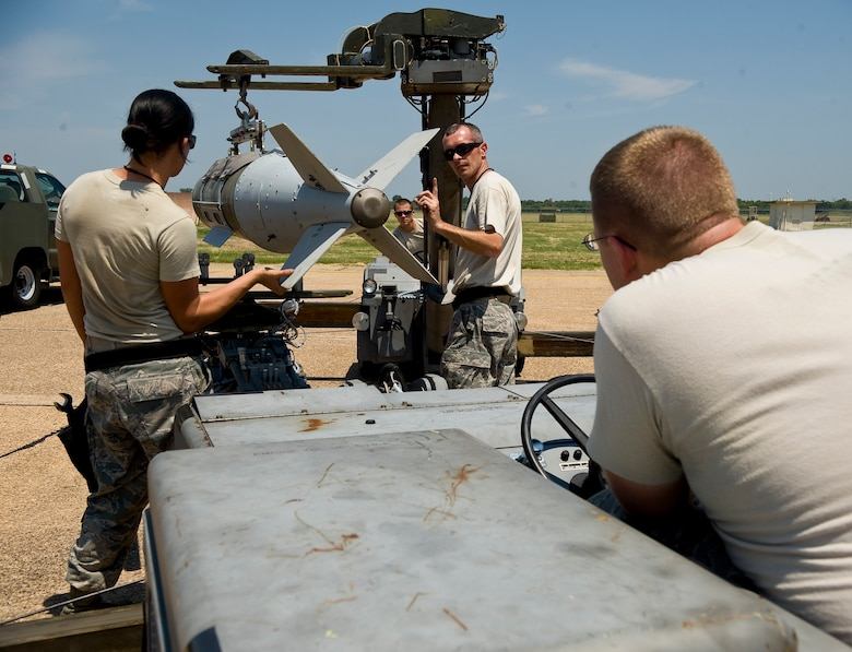 Airmen from the 2nd Maintenance Operations Squadron weapons standardization section maneuver an inert GBU-31 joint direct attack munition before loading it onto a B-52H Stratofortress on Barksdale Air Force Base, La., Aug 14. The JDAM is equipped with telemetry which provides feedback about the bomb's trajectory and speed. The weapon load is part of exercise Combat Hammer, meant to evaluate the generation and employment of guided munitions. (U.S. Air Force photo/Staff Sgt. Chad Warren)(RELEASED)
