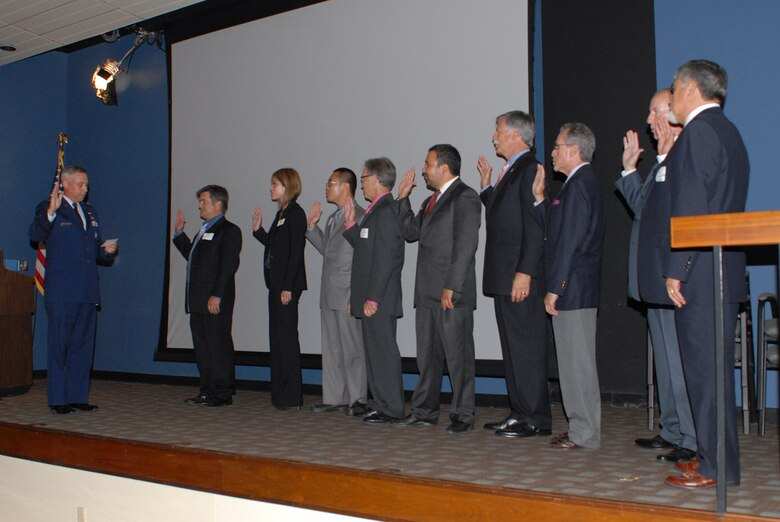 Brigadier Gen. Kenneth Moran, Space and Missile Systems Center's Program Management and Integration director, swears in the League of California Cities' Los Angeles County Division's new officers at a dinner in Redondo Beach, Aug. 2. The general was also the keynote speaker at the event. The division is the largest of 16 regional divisions in the state and is comprised of 86 cities, representing more than 11 million people across 4,500 square miles. (Photo by Hien Vu)