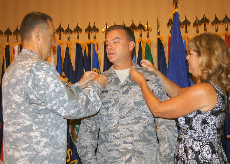 "Newly promoted Brig. Gen. David W. Newman, gets ""pinned"" Sunday by his wife, Karen, and by Maj. Gen. Stephen L. Danner, adjutant general of the Missouri National Guard, August 11. Newman serves as chief of the Missouri National Guard Joint Staff. (National Guard photo by Bill Phelan)"