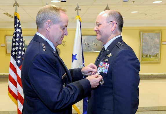 Air Force Chief of Staff Gen. Mark A. Welsh III presents Maj. Gen. James Jackson with the Distinguished Service Medal during Jackson's promotion ceremony at the Pentagon on Aug. 16, 2012.  Jackson, who is the chief of the Air Force Reserve and commander of Air Force Reserve Command, was promoted to lieutenant general during the ceremony.  (U.S. Air Force photo/Scott M. Ash)