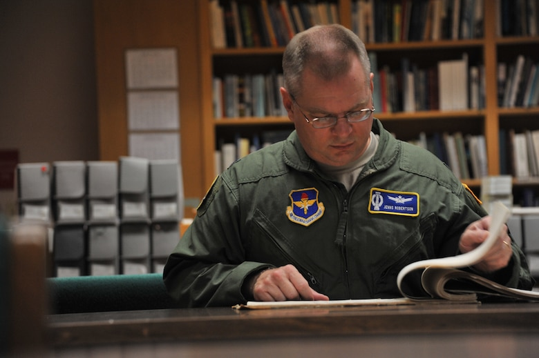 Lt. Col. Jenns Robertson, Air and Space Power Strategist at the Air Force Research Institute, researches about Theater History of Operations at Maxwell Air Force Base, Aug. 17. THOR is database of bombs dropped from American military aircraft from World War One through current times. (U.S. Air Force photo by Airman 1st Class William Blankenship)