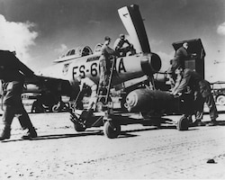 Ground crew prepares an F-84 from the Florida ANG's 159th Fighter Squadron for a combat mission during the Korean War. Unit was temporarily based in South Korea.