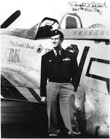 "Major Donald J.Strait with P-51D ""Jersey Jerk"" in Europe, 1945. Enlisting in the New Jersey National Guard before World War II, Strait went to flight school, becoming one of two fighter aces with National Guard backgrounds with 13.5 victories. Postwar, Strait commanded the New Jersey Air National Guard, retiring in 1978 as a major general."