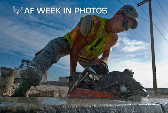 Senior Airman Andrew Higginbotham uses a concrete saw to cut out a piece of curb during the construction of a parking lot at Nellis Air Force Base, Nev., Aug.15, 2012. The parking lot will be a general parking lot for work centers around the area. Higginbotham is a 99th Civil Engineer Squadron heavy equipment and pavements journeyman. (U.S. Air Force photo/Airman 1st Class Daniel Hughes)