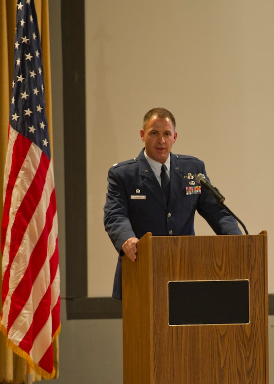 Lieutenant Col. Nathan Hansen, 29th Attack Squadron commander, speaks during an MQ-9 Reaper winging ceremony at the Holloman Air Force Base, N.M., base theater Aug. 16. The graduation ceremony marks the first time a student pilot in the Air Force Specialty Code 18X has completed the MQ-9 Basic Course without having been previously qualified in a manned aircraft. The basic course at Holloman AFB, which is about six months long, accounts for almost half of the total 18X training pipeline. (U.S. Air Force photo by Senior Airman Siuta B. Ika/ Released)