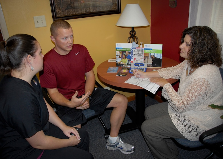 Angela Teixeira, an Airman and Family Readiness Center community readiness consultant, presents financial strategies to Tech. Sgt. Thomas Piening, a member of the 33rd Maintenance Group, and his wife, Sarah.  Eglin's A&FRC's personal financial readiness program offers classes on a mandatory, regular, bi-monthly, monthly and quarterly basis, as well as guidance by appointment.  (U.S. Air Force photo/Kevin Gaddie)