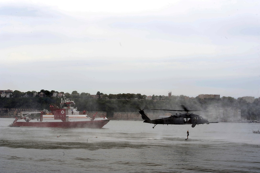 The 106th Rescue Wing of the New York Air National Guard performs a water rescue demonstration with an HH-60 Pave Hawk helicopter during Air Force Week 2012 in New York City on Aug 19. (U.S. Air Force photo/Senior Airman Andrew Lee)