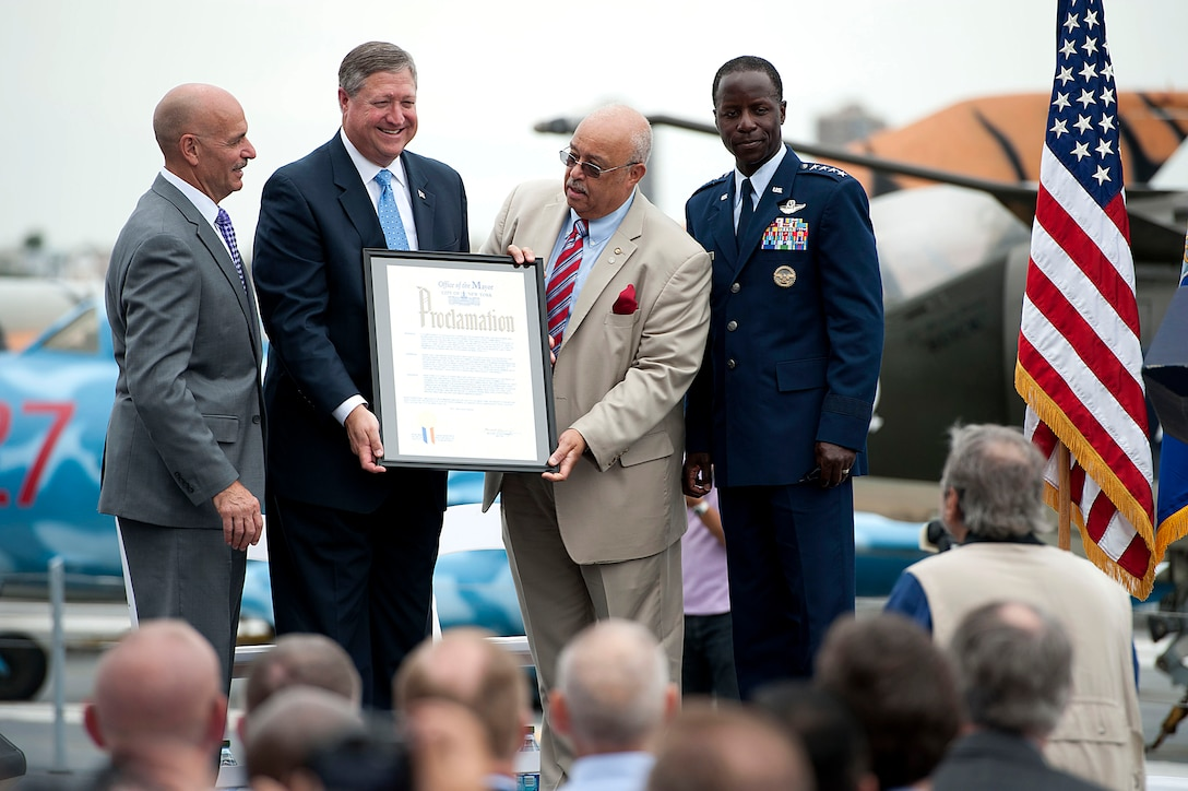 The commissioner of the New York City mayor's Office of Veteran Affairs, Terrance R. Holliday, center, delivers the proclamation stating that the week of August 19-22 is officially Air Force Week in New York City on Aug. 19. (U.S. Air Force photo/Senior Airman Andrew Lee)