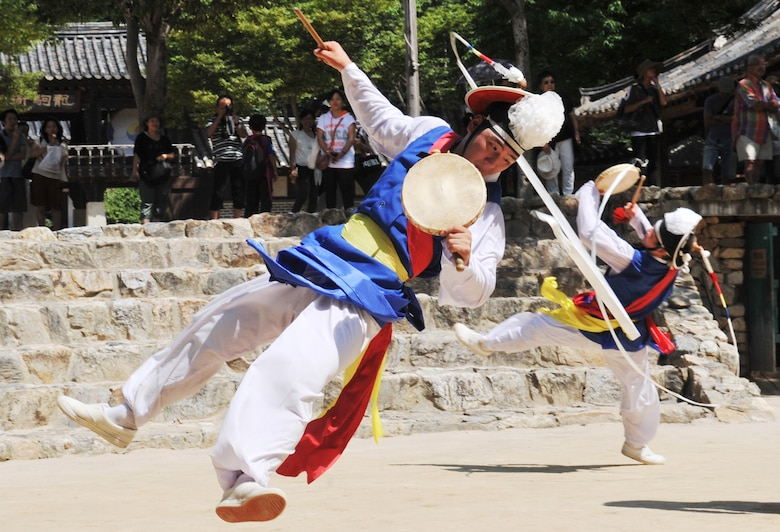 Performers at the Korean Folk Village exercise their music and dancing skills during a show Aug. 17, 2012. The folk village's 243 acres contain more than 260 traditional Korean homes reminiscent of the Joseon Dynasty period from 1392-1910. (U.S. Air Force photo/Staff Sgt. Stefanie Torres)