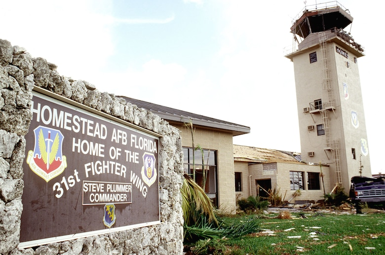 Damaged control tower and welcome sign. Hurricane Andrew damaged every building on base and destroyed many. (U.S. Air Force photo/MSgt Don Wetterman)