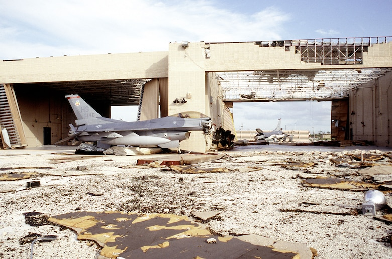 A pair of F-16 Fighting Falcons which were left in the alert complex lay destroyed after the hangar they were stored in was destroyed by Hurricane Andrew (U.S. Air Force photo/MSgt Don Wetterman)