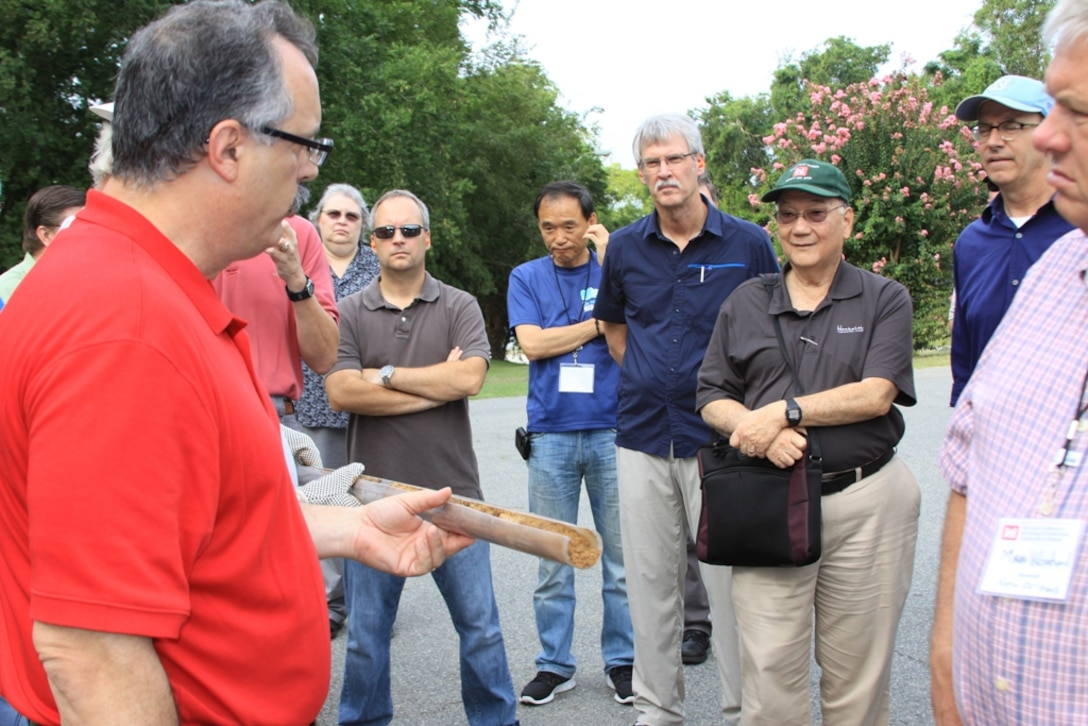 SAVANNAH, Ga. — Matthew Delano, U.S. Army Corps of Engineers Savannah District (left), shows a soil sample to a group of USACE engineers at the Joint Conference of the Geology and Geotechnical Communities of Practice, Aug. 16, 2012.