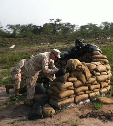 U.S. Marines with the 24th Marine Expeditionary Unit prepare demolitions charges on a training range in Uganda while participating in a training mission with members of the Uganda People's Defense Force.  The Marines have been in Uganda since July providing training assistance to the UPDF in a variety of skills including marksmanship, small unit tactics, and engineering.  The 24th MEU is deployed with the Iwo Jima Amphibious Ready Group as a theater reserve and crisis response force in the U.S. Central Command and 5th Fleet areas of responsibility.