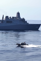 A rigid-hull inflatable boat passes the USS Green Bay after transporting servicemembers from the USS Rushmore, Aug. 18, during the 15th Marine Expeditionary Unit and Peleliu Amphibious Ready Group's final pre-deployment training evolution, Certification Exercise. The MEU's mission capabilities and performance will be evaluated during the exercise to ensure it is ready to deploy later this year.