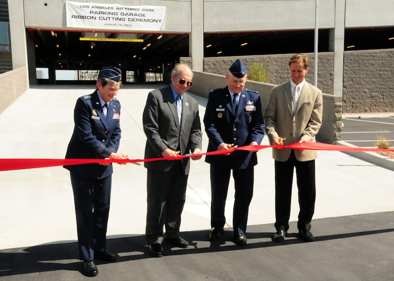 Lieutenant General Ellen Pawlikowski, Space and Missile Systems commander, is joined by El Segundo Mayor Carl Jacobson; Col. Sam McNiel, 61st Air Base Group commander; and Jeff Harper, Harper Construction president, in cutting the ribbon to open Los Angeles Air Force Base's new parking garage. The new garage, opened on Aug. 10, adds more than 200 new parking spots. (Photo by Jim Gordon)