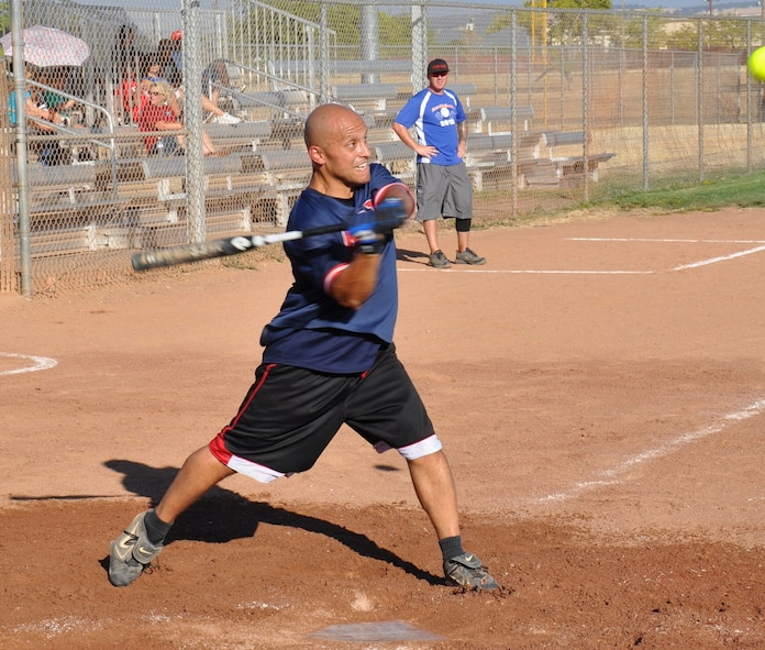 Staff Sgt. Erick Bran, 9th Maintenance Squadron, swings at a pitch during Beale's Intramural Softball Championships at Beale Air Force Base, Calif., Aug. 16, 2012. The 9th MXS defeated 9th Munitions Squadron with a 10-9 victory. (U.S Air Force photo by Staff Sgt. Robert M. Trujillo)