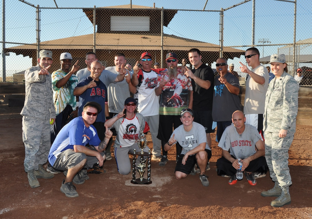 The 9th Maintenance Squadron Intramural Softball Team poses for a picture at the conclusion of Beale's Intramural Softball Championships at Beale Air Force Base, Calif., Aug. 16, 2012. The 9th MXS defeated the 9th Munitions Squadron with a 10-9 victory. (U.S Air Force photo by Staff Sgt. Robert M. Trujillo)
