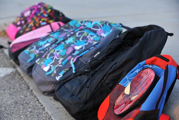 GOODFELLOW AIR FORCE BASE, Texas-- Backpacks donated by the 17th Security Forces Squadron sit along the curb of the School Age Program building Aug. 17. The 17th SFS raised money to donate backpacks and school supplies to children before the start of school. (U.S. Air Force photo/ Airman 1st Class Michael Smith)