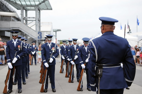 The U.S. Air Force Honor Guard Drill Team stand at ceremonial at-ease Aug. 19 in New York, N.Y., waiting for the order of attention from Master Sgt. Whitfield Jack, superintendent of the Drill Team, and native of Brooklyn, N.Y. The Drill Team is performing during Air Force Week 2012. (U.S. Air Force photo by Senior Airman Tabitha N. Haynes)