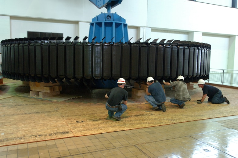 KUTTAWA, Ky. — A work crew with National Electric Coil from Columbus, Ohio secures a 270-ton rotor assembly onto a pedestal at the Barkley Dam Hydropower Plant here, Aug. 16, 2012. The U.S. Army Corps of Engineers Nashville District is rehabilitating a hydropower generator damaged in an electrical fire in January 2010.