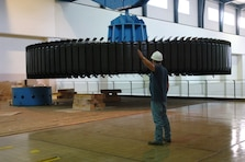 KUTTAWA, Ky. — A crewman with National Electric Coil from Columbus, Ohio guides a 270-ton rotor assembly onto a pedestal at the Barkley Dam Hydropower Plant here, Aug. 16, 2012. The U.S. Army Corps of Engineers Nashville District is rehabilitating a hydropower generator damaged in an electrical fire in January 2010.