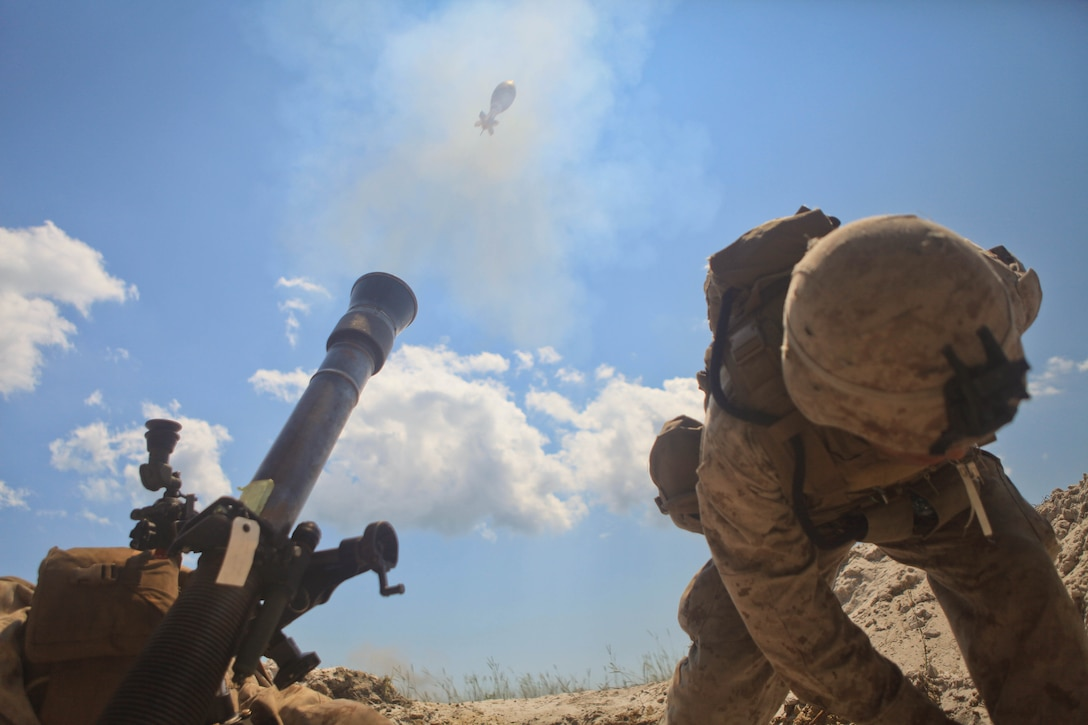 Private First Class Luis Rivera, an Oviedo, Fla. native and mortarman with Hellfire Platoon, Weapons Co., 3rd Battalion, 2nd Marine Regiment employs an 81mm mortar during a training exercise aboard base, August 14. Rivera and the other Marines of 3/2 conducted a two-day fire support coordination exercise August 14-15 in conjunction with artillery, naval guns and close air support.