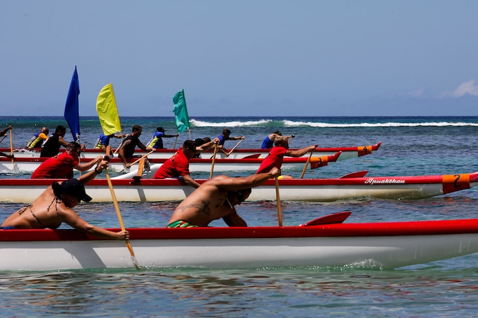 Service members get off to a strong start during Duke's Ocean Fest Na Koa 2012 Canoe Race in the waters off the Hale Koa Hotel here Aug. 18. The races were a competition for bragging rights among service members throughout Oahu who are recovering from injury before returning to full duty or transitioning out of the military.