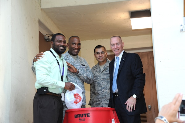 Maj. Gen. Alfred Stewart (second from left) , Air Force Personnel Center commander, joins Jacob Love, AFPC entitlements branch, Chief Master Sgt. Rubin Gonzales, AFPC command chief and Todd Fore, AFPC executive director, at a Feds Feeds Families food bank donation barrel during a collection event held at AFPC on Joint Base San Antonio-Randolph, Texas Aug. 15. (U.S. Air Force photo by Rich McFadden)
