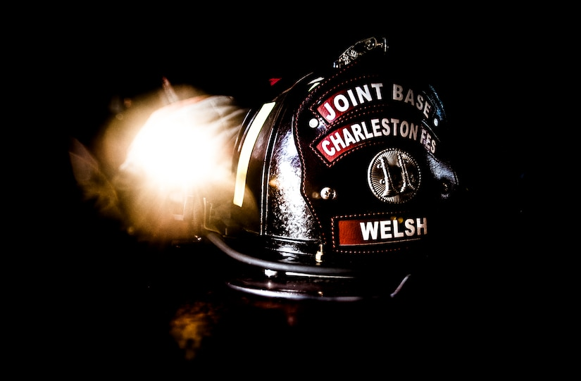 A firefighter's helmet is equipped with a flashlight to help navigate through dark areas. Each firefighter has six pieces of equipment to put on in less than two minutes when responding to an emergency call. (U.S. Air Force photo/Senior Airman Dennis Sloan)