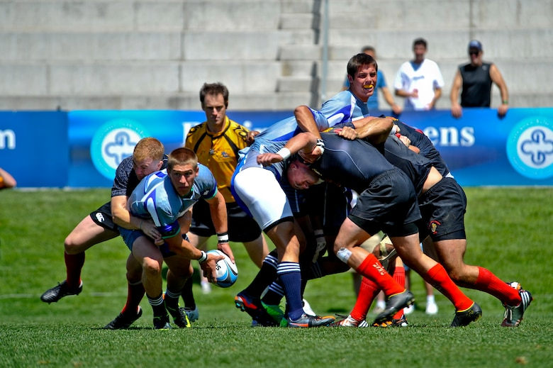 GLENDALE, Colo. --  The Air Force rugby team gains possession of the ball after a scrum against Marine rugby players Aug. 19. The Air Force lost their first Armed Forces Rugby Sevens Championship match in eight years, 31-33, to the Marines. (U.S. Air Force photo by Staff Sgt. Kathrine McDowell)