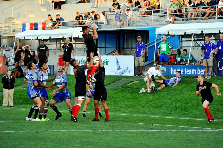 GLENDALE, Colo. --  The Marine rugby team maintains possession of the ball during their first match against the Air Force rugby team Aug. 18. The Marines went to win the Armed Forces Rugby Championship match against the Air Force 33-31.  (U.S. Air Force photo by Staff Sgt. Kathrine McDowell)