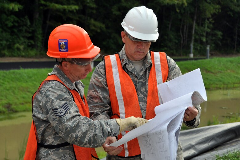 Staff Sgt Robert Ataway, a structures craftsman assigned to the 307th Civil Engineer Squadron from Barksdale Air Force Base, La., talks with Maj. Allen Spillers, chief of operations, 307 CES, about the next phase of construction of a Pre-Engineered Building at Youngstown Air Reserve Station, Vienna, Ohio, Aug. 14, 2012. They were part of a 29-person detail from Barksdale that spent two weeks at Youngstown ARS assisting 910th Civil Engineer Squadron personnel build a Prime Base Engineer Emergency Force (Prime BEEF) training area. (U.S. Air Force photo by Master Sgt. Jeff Walston)
