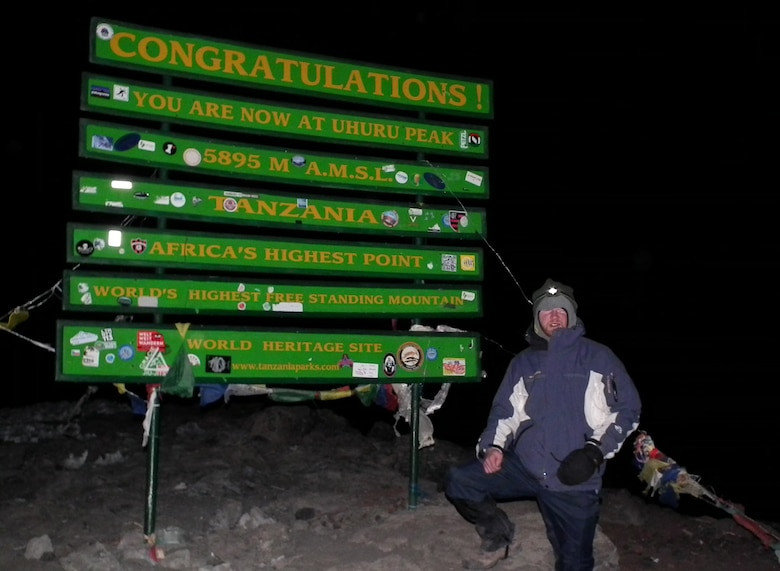 TANANIA — Jay Wallace, assistant counsel for the U.S. Army Corps of Engineers Middle East District, stands at Uhuru Peak, the highest point of Kilimanjaro, just before sunrise.