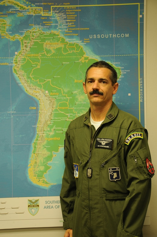 DAVIS-MONTHAN AIR FORCE BASE, Ariz. –  Col. Schumann, a fighter pilot in the Brazilian air force,  worked as a chief of combat operations during PANAMAX 2012 alongside Air Forces Southern, Aug. 6-17.  PANAMAX is an annual U.S. Southern Command-sponsored exercise that focuses on ensuring the defense of the Panama Canal. One of the most important benefits of multinational exercises like PANAMAX is the fact that all the participants were able to exchange their experiences, expertise gained new knowledge about each other's culture and people. These interactions strengthen our bonds across the region and foster long-lasting friendships and an understanding among the partner nations, ultimately benefiting the security of the region. (USAF photo by Tech. Sgt. Andria Sapp).