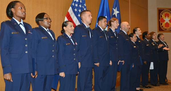 The first class of 12 Air Force nursing residents participate in a graduation ceremony Aug. 20 at the San Antonio Military Medical Center. (Photo by Lori Newman, JBSA-Fort Sam Houston Public Affairs)
