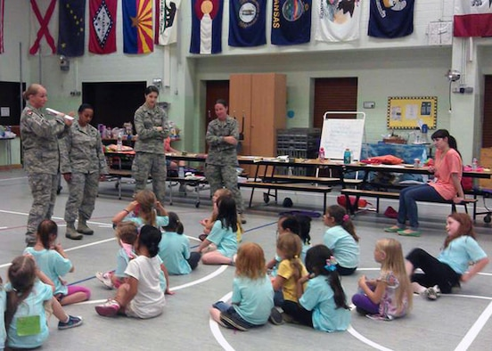 SPANGDAHLEM AIR BASE, Germany – From right to left, Police Officer Melanie Bryant, Capt. Lidia Iyassu, Airman 1st Class Paige Shaw and Capt. Julie Roloson, 52nd Security Forces Squadron, teach Girl Scouts from USA Girl Scouts Overseas at the Spangdahlem Elementary School here Aug. 21 during a summer camp. The Girl Scouts partnered with the 52nd SFS to learn techniques in identifying and reacting to strangers, basic defensive striking techniques, and strategies for getting attention during an emergency. (U.S. Air Force photo by Tech. Sgt. Jose De Jesus/Released)