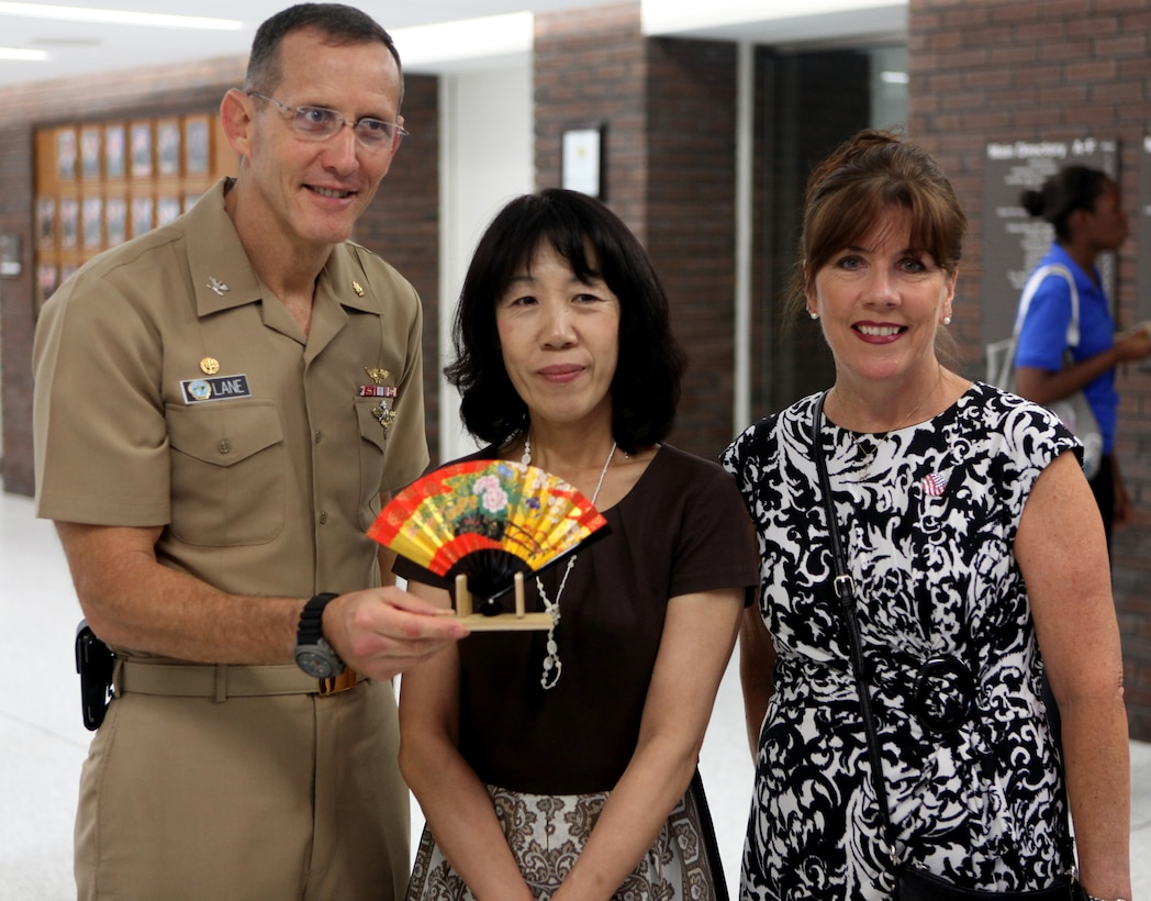 Navy Capt. David Lane (left), commanding officer of Naval Hospital Camp Lejeune, Toshiko Iwasaki (center), wife of the Chief of Staff for Japan's Self-Defense Forces Gen. Shigeru Iwasaki, and Cindy Fox, wife of Maj. Gen. Raymond Fox, commanding general of II Marine Expeditionary Force, pose for a picture with a gift Iwasaki presented to Lane aboard Marine Corps Base Camp Lejeune Aug. 21. Lane showed Iwasaki around the hospital during her visit to NHCL.