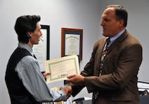 WINCHESTER, Va. — Bill Rogers, U.S. Army Corps of Engineers Middle East District counsel (right), presents Pierce Hamilton with a certificate of appreciation for his summer service to the District. Hamilton, who attends the Rochester Institute of Technology in New York, is the district's first summer hire under the Workforce Recruitment Program, sponsored by the Departments of Defense and Labor. DOD's goal is to increase the number of individuals with disabilities in the workforce.