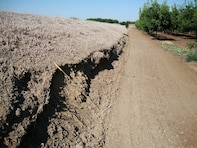 STOCKTON, Calif. — A road encroaches on the toe of a levee in the Stockton, Calif., area, shown during a levee inspection in 2010. The U.S. Army Corps of Engineers inspects levees in its Rehabilitation and Inspection Program to ensure levees don't pose an unacceptable risk to lives and to provide levee managers and residents with detailed information on the condition of levees to help them make informed decisions about safety.