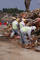 In the spring of 2011, tornados ripped through the state of Alabama. Several Charleston District personnel volunteered to deploy to the area to clean up debris and get the town back on its feet.