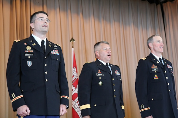 (from left) Lt. Col. Edward Chamberlayne, Maj. Gen. Todd Semonite (SAD Commander), and Lt. Col. Jason Kirk (former SAC Commander) stand at attention during the ceremony.