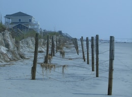 Folly Beach dunes continue to do their job of protecting homes in the event of a storm.
