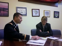 Lt. Col. Chamberlayne discusses the district's plans for FY 2013 with a staff member of the SC delegation.