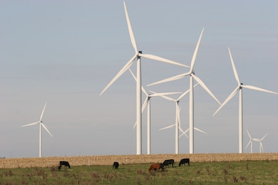 Wind turbines working in a field in Michigan.