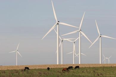 Wind turbines working in a field in Michigan.